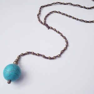 Long single bead necklace